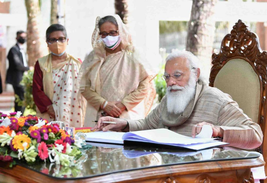 Prime Minister Modi singing orders and signifying Modi Administration