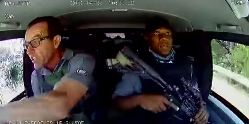 Police officers escaping firing in South Africa