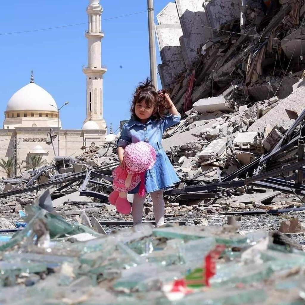 Baby girl standing on the rubble of collapsed after Israel bombing in Gaza strip, Palestine after Gaza under attack