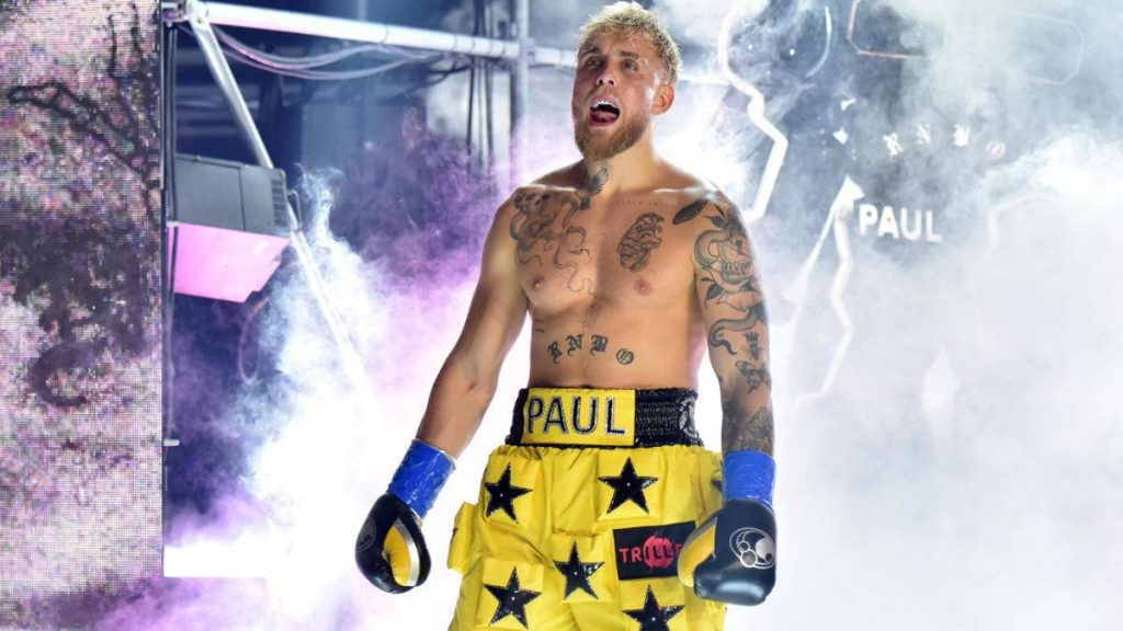 Jake Paul standing in boxing arena and boasting